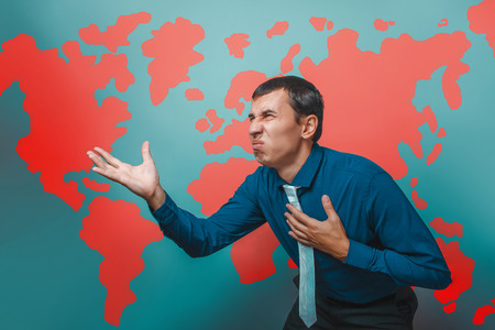 irritation: man male teacher Professor businessman showing on the United States a country disgusted anger irritation world map infographics studio background Stock Photo