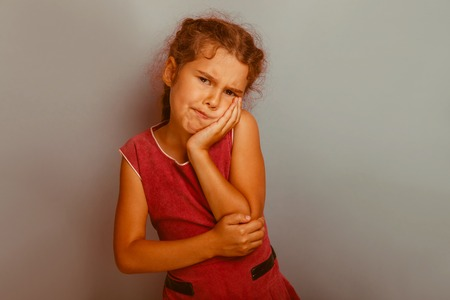 decade: Girl European appearance decade  toothache on a blue  background retro Stock Photo