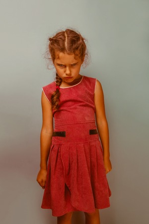 frowns: Girl European appearance decade  angry frowns blue background retro