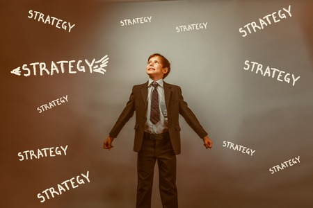 Teen boy businessman arms outstretched looking up striving for success looks up the idea inscription strategy infographics aim aspiration business retro