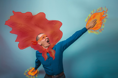 superpower: superhero  businessman man raised his hands superpower flying behind a cloak photo sketch studio Stock Photo