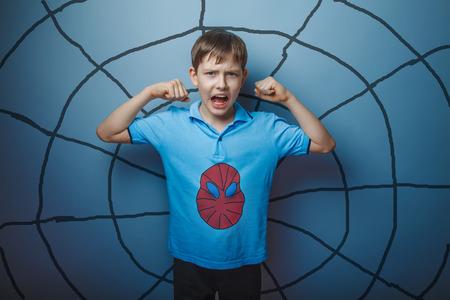 spider man: Spider man superhero  teen boy raised his arms shouting skin stren