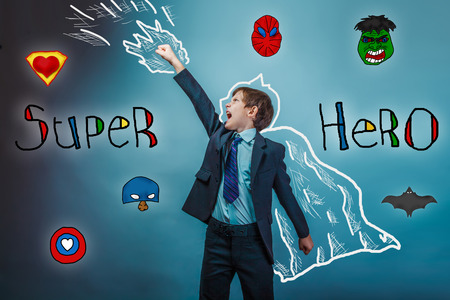 super man: superhero boy raised his hands superpower  businessman flying photo behind cloak  studio teenager Stock Photo