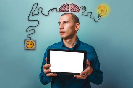 booster: a man looking away and holding a tablet in the hands of a white screen with a brain booster charge plug wires and sketch infographics