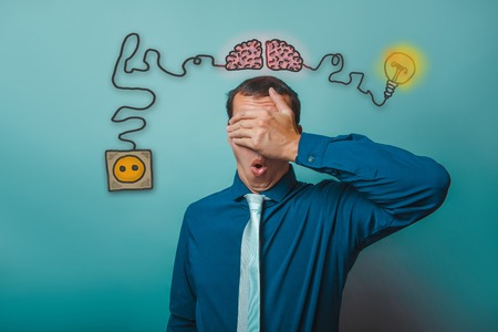 booster: businessman hand man closed his eyes and opened his mouth in amazement brain booster charge plug wires and sketch infographics