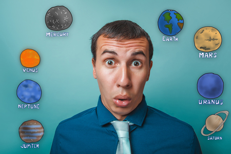 eyes opened: businessman man wonders round eyes opened her mouth planets of the solar system astronomy Stock Photo
