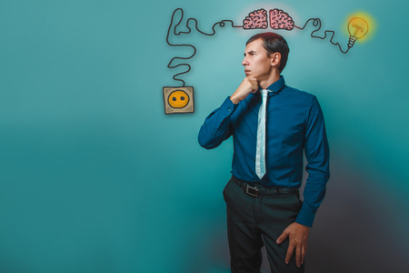 booster: businessman thoughtful man hand on his chin thinks deeply brain booster charge plug wires and sketch infographics