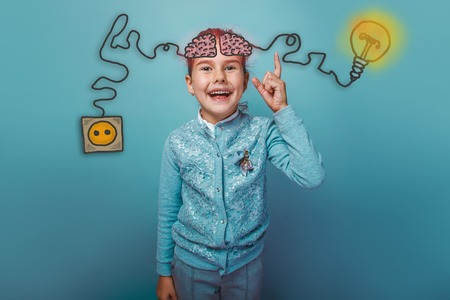 booster: een girl raised her index finger laughing joy conclusion from thinking brain booster charge charging plug wire and sketch infographics Stock Photo