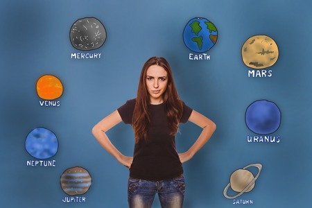 frowned: girl frowned angry hand on the body of the planet of the solar system astronomy