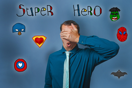 super man: a man put his hand over the face of a businessman superhero super power at the photo studio Icons hero
