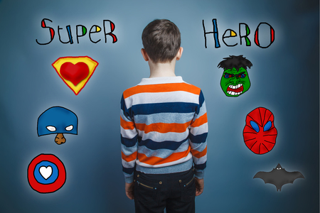 adolescent: adolescent boy turned and looks ahead rear view photo superhero super power for studio Icons hero