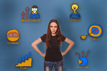 frowned: girl in shirt and jeans frowned dissatisfied with her hands on her hips collection of business icons management team goal sketch Stock Photo