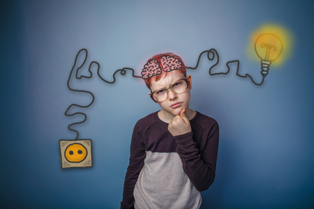booster: Teenage boy in glasses thinking brain booster charge charging plug wire and sketch infographics