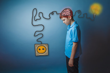 booster: Teenage boy stands sideways lowered his head thinking brain booster charge charging plug wire and sketch infographics