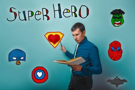 frowned: Businessman points his hand to the side and frowned vchityvayas in the book superhero super power at the photo studio Icons hero