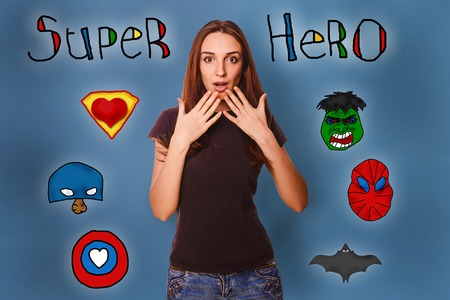 wonders: Girl hands in amazement at the wonders face super hero super power at the photo studio Icons hero Stock Photo