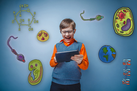 parasite: Boy retro style sunglasses laughing and working on a tablet joyful icons biology education formation of the embryo cell parasite Stock Photo