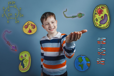 boy smiling: Boy smiling and holding in the palm of icons biology education formation of the embryo cell parasite