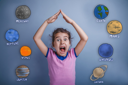 arms above head: Teen girl yelling house folded her arms above her head game of the planet of the solar system astronomy