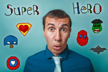 mouth open: Male businessman surprised face mouth open eyes bulged superhero super power at the photo studio Icons hero