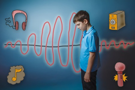 frowned: teenage boy bowed his head down frowned and pondered the sound wave music radio sketch symbol Stock Photo