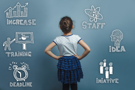 put forward: teenage girl in a blue skirt put his hands on his waist and is looking forward rear view thumbnail icons set business strategy Stock Photo