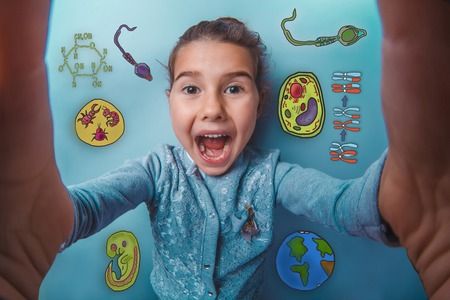 opened mouth: Girl makes a photo of yourself, and opened her mouth laughing joyful icons biology education formation of the embryo cell parasite Stock Photo