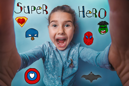 opened mouth: Selfe joy girl opened her mouth super hero super power at the photo studio Icons hero