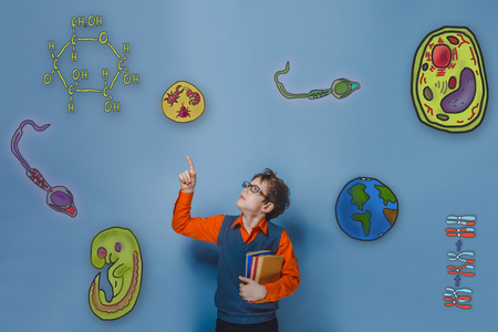 starch: retro style teenage boy teenager with glasses shows a finger upward icons biology education formation of the embryo cell parasite Stock Photo