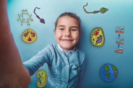 embryo: Self teen girl smiling happy icons biology education formation of the embryo cell parasite Stock Photo
