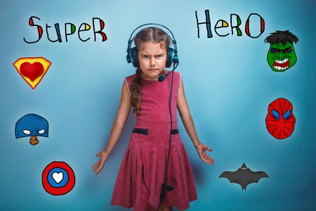 frowned: teen age girl with headphones he frowned and spread his arms superhero super power at the photo studio Icons hero