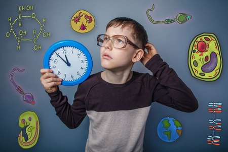 parasite: Teenage boy in glasses holding a clock hand and scratching his head wondering icons biology education formation of the embryo cell parasite