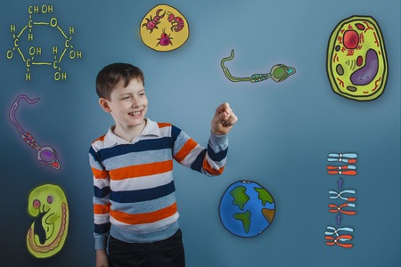 parasite: teenage boy laughing and holding a finger pleased icons biology education formation of the embryo cell parasite Stock Photo