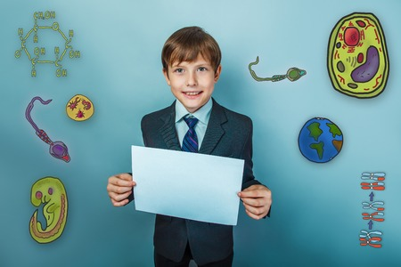 parasite: Teenage boy smiling businessman holding a piece of paper and a set of icons biology education formation of the embryo cell parasite Stock Photo