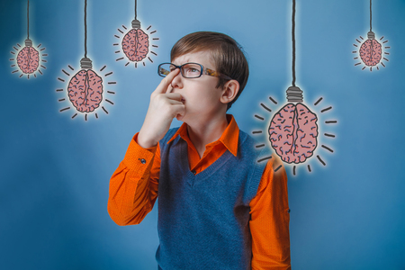 adolescent: adolescent boy straightens the finger points forward looking retro style of the brain bulb creative idea Stock Photo