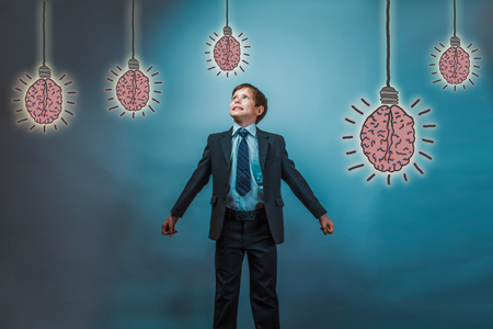 adolescent: adolescent boy looking up laughing businessman opened his arms to the sides brain bulb creative idea Stock Photo