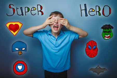 opened mouth: Teen boy screaming opened his mouth and closed his eyes with his hands superhero super power of the photo studio Icons hero