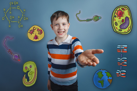 parasite: Teen boy laughs and holds out his hand forward icons biology education formation of the embryo cell parasite Stock Photo