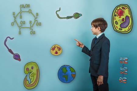 parasite: Teen boy businessman turned sideways and points a finger at Icons biology education formation of the embryo cell parasite Stock Photo