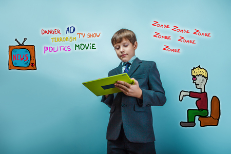 adolescent: adolescent boy holds a business style tablet media influence zombies tv news