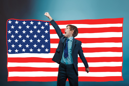 yells: adolescent the boy businessman raised his hand up and yells American flag USA