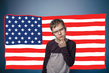 frowned: adolescent the boy in glasses frowned American flag USA
