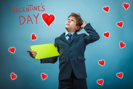 adolescent: adolescent the boy scratching his head keeps the tablet Valentines Day celebration cartoon sketch
