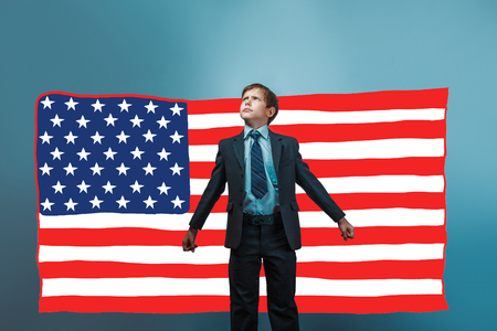 threw: business style a teenager the boy threw his arms in the American flag USA Stock Photo