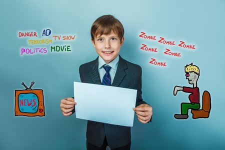 teenage boy: business style Teenage boy holds a a sheet of paper the influence of the media zombie TV News Stock Photo