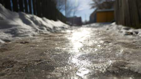 footpath in city of ice and snow is slippery winter frozen