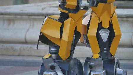 Feet of the foot of the yellow robot. Transformer robot terrible