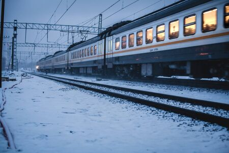 Train Carriages Passing in the Snow