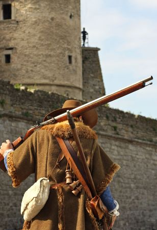 Musketeer against the backdrop of the castle photo