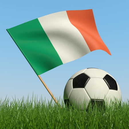 Soccer ball in the grass and the flag of Ireland against the blue sky. 3d photo